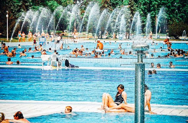 People sitting at the pools of Palatinus Budapest