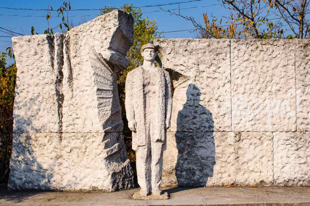 Memento Park: a worker breaks through a wall